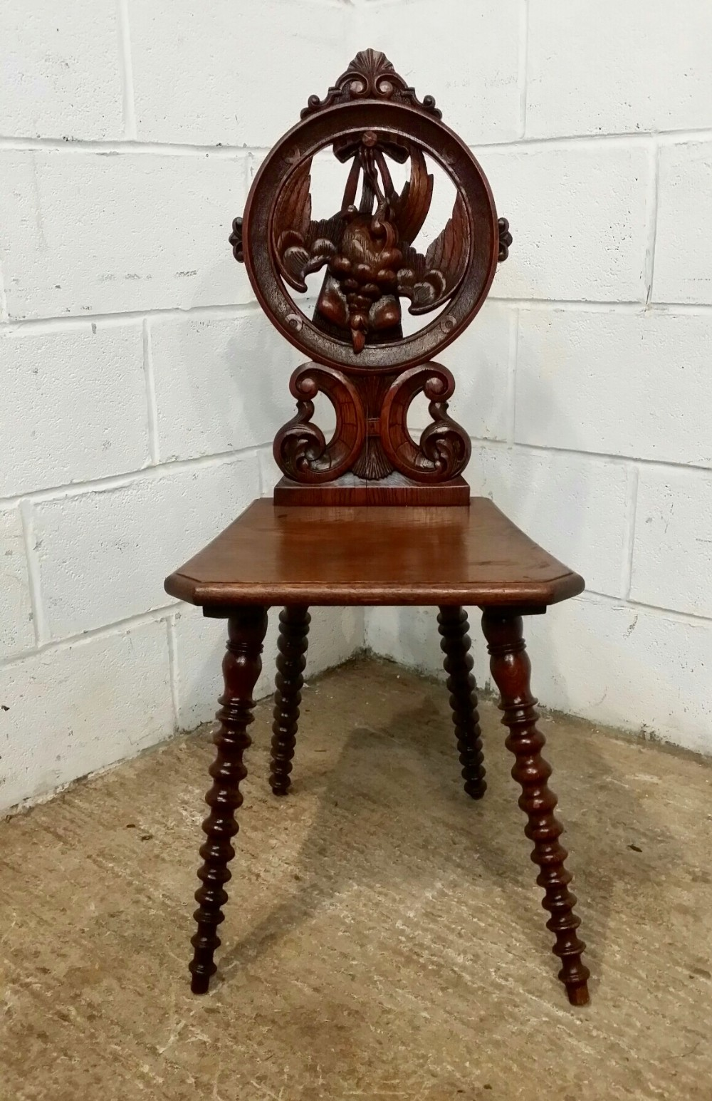antique 19th century black forest oak hall chair with hanging pheasant c1880