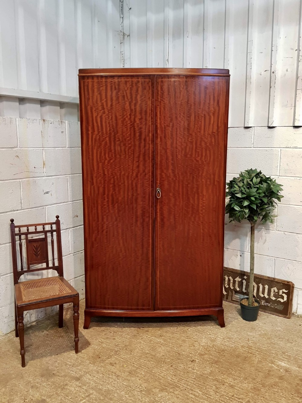 antique bow front figured mahogany double wardrobe c1920